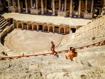 It's not every day you see girls in bikini's posing in roman ruins for their friend with an iPad